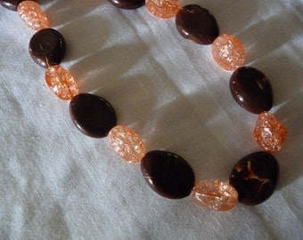 Brown necklace with sparkly orange beads