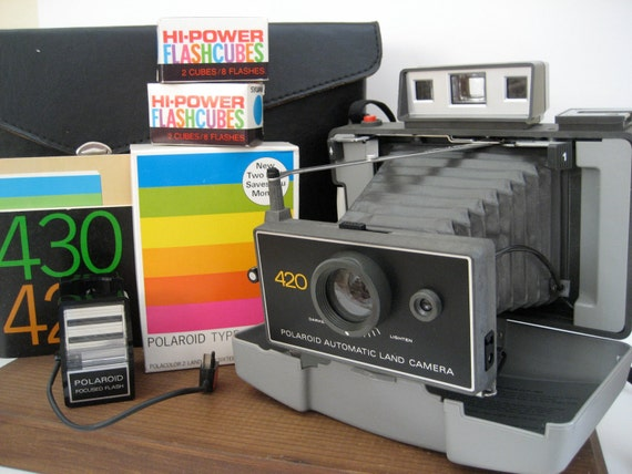 Vintage Polaroid Land Camera 420 with Case, 2 Packs of film, Flash, Flash Bulbs and Manual