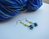 Merino nylon sock yarn, blue sock yarn, water lilies yarm, and beaded earrings