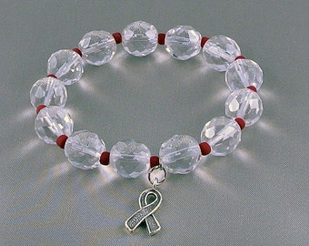 AIDS , Heart Disease Awareness Bracelet, Stretch Bracelet with Hope Ribbon Charm, with Donation