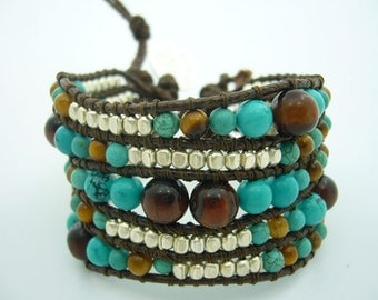 Turquoise,tiger eye and beads on leather bracelet