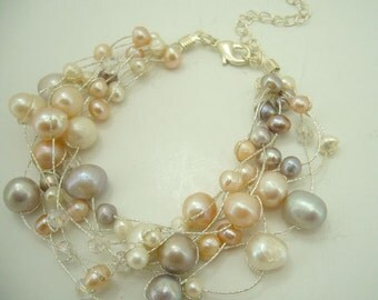 Light peach and pink freshwater pearl bracelet.