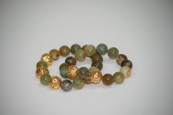 Elastic cord custom jewelry bracelets with jade stones and gold tone spacers