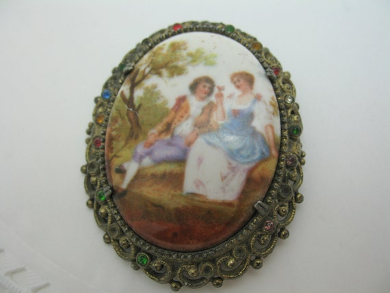 Porcelain hand painted brooch with couple in antique gold filagree setting with stones