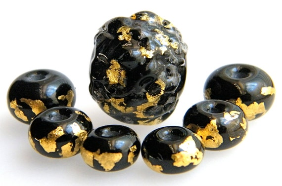 reserve for Julie Lampwork graduated bead set of 7 beads in 23k Italian gold on deep black glass