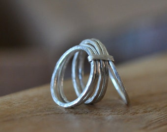 5 sterling silver stacking rings joined with band.