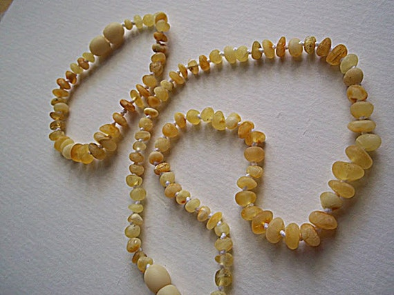 Baltic Amber Baby Teething Necklace & Baby Bracelet.  Unpolished   white colour  beads. Effective Pain Relief Solution.