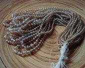 Hank of Champagne Coloured Glass Beads 1970