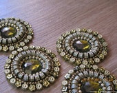 Hand embroidered applique, round shape embellishment with a green large stone and copper sequins