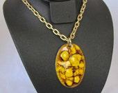 Yellow enamel burst pendant w/ long Gold Chain