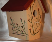 Birdhouse with tan base and burgandy roof with burgandy flowers hand painted