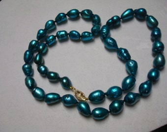 Tahitian-look freshwater pearl necklace with 14k gold clasp.