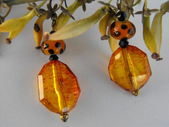 RESERVED    MarieDangle Earrings with leopard print glass beads and amber
