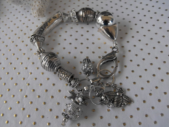 CHUNKY SILIVER BRACELET with hammered tube bead, tons of dangles, heavy metal, rhinestones, resins