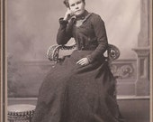 Antique Cabinet Photo of a Very Bored Woman