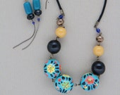 Necklace with  painted wooden beads (turquoise, black, orange and yellow)