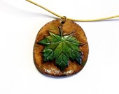 Green and teal rustic ceramic pendant necklace with ocher leather cord thread