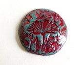 Handmade clay cabochon ceramic cabochon red and turquoise  with floral motif