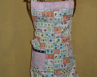 Apron in pastel flowers with pretty pink on reverse side, perfect for your favortie recipes
