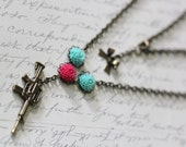 Gun necklace AK-47 long. Pink turquoise resin mum flowers brass. handmade necklace jewelry