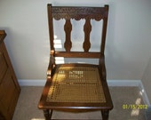 Victorian chair with a cane bottom seat.