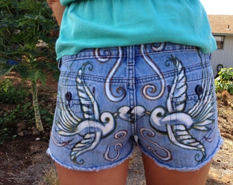 upcycled denim shorts with hand drawn sparrows with mended heart design