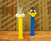 Original vintage Looney Tunes pez dispensors with feet Daffy and Bugs