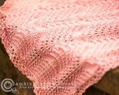 Warm and cuddly baby blanket sized for car seat, stroller or just cuddling in pink.