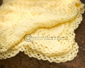 Warm and cuddly baby blanket sized for car seat, stroller or just cuddling in light creamy yellow