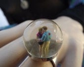 Love declaration - romantic resin ring with passionate couple.