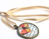 BUTTERFLY EFFECT bronze necklace, pendant in summery red, yellow and white colors