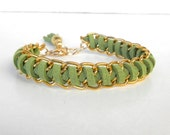 Gold double chain, green suede cord