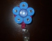 Light and dark blue ID clip-medicine vials