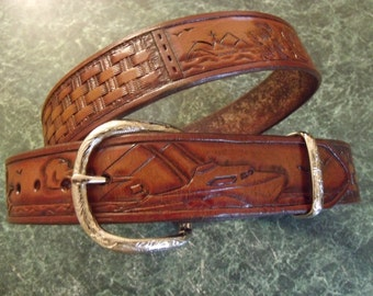 Hand tooled leather belt. Salt water fish theme with boats and marlins.Can be personalized