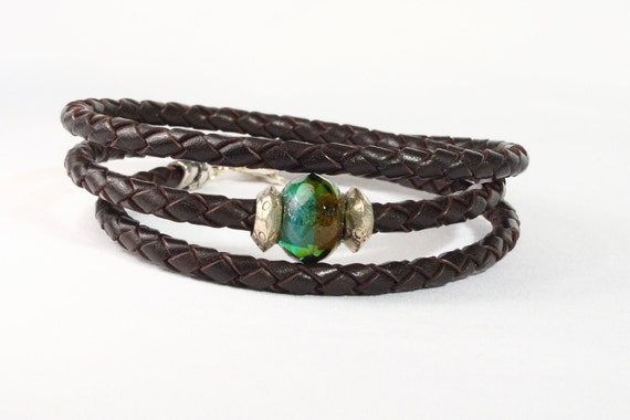 Men's brown leather wrap bracelet.  Green and brown glass bead with Thai silver spacers.  Silver toggle clasp.