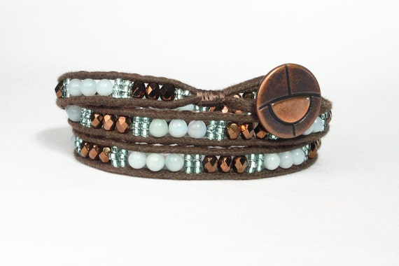 Triple wrap bracelet in Amazonite, bronze fire polish and seed beads.  Bronze button.