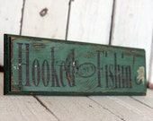 Hooked on Fishing - Reclaimed, painted and distressed wood sign - Rustic, Home Decor, Wall Art, Man Cave Decor