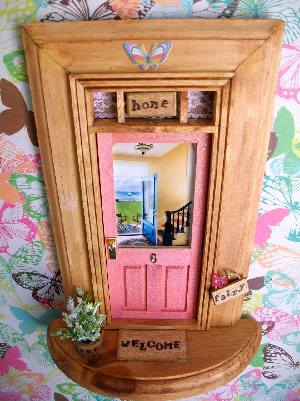 Fairy door pink sparkle door backyard beach for Idea behind fairy doors
