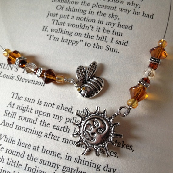 Beaded Book thong / Bookmark with vintage amber beads and silver sun charm