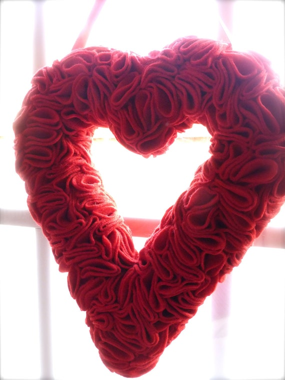 Only ONE available.  Valentine's Day Heart Shaped Wreath covered with Red Felt.