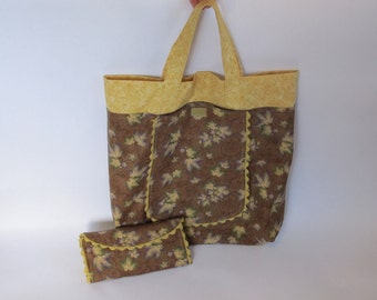 Tote Bag That Folds Into A Purse Is Made Of Cotton Fabric