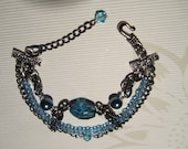 Aged sterling silver with aquamarine pearls and Swarovski crystals Bracelet