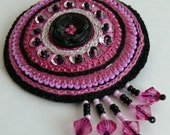 Richly laced hand-embroidered pearly pink-black mandala brooch