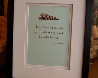 "Framed quote by Jacques Cousteau, ""The sea, once it casts its spell, holds one in its net of wonder forever."""