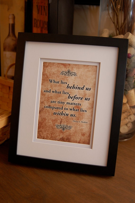 "Framed quote by Henry Haskins, ""What lies behind us and what lies before us..."""