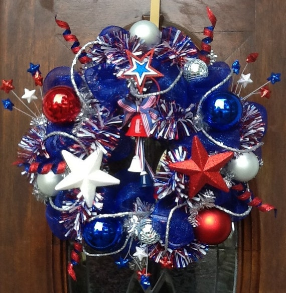 24 inch Patriotic Wreath can be proudly displayed on your front door starting Memorial Day thru 4th of July, Labor Day and Veteran's Day.