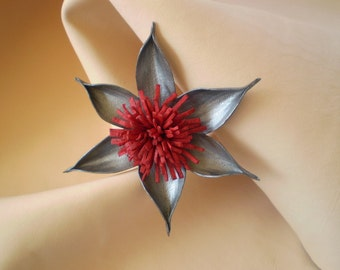 Silver and red leather flower.