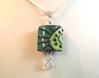 Necklace green and brown glass art lampwork bead, clear crystals