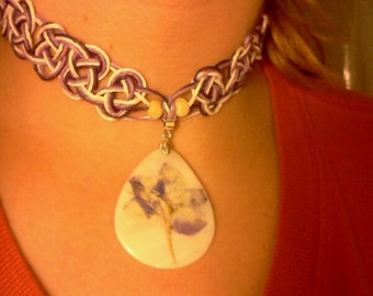 Purple celtic knotted hemp necklace with pressed flower shell pendant