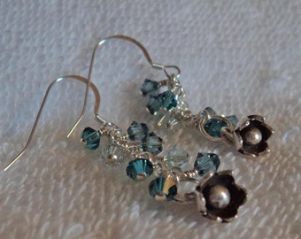 Swarovski crystal beads, sterling silver, and tribal silver dangle earrings.